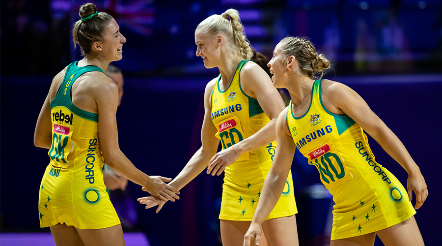 Australian Diamonds Jamie-Lee Price and Jo Weston congratulate debutant Sarah Klau on taking to the court in match one of the Netball World Cup against Northern Ireland at Liverpool's M&S Bank Arena