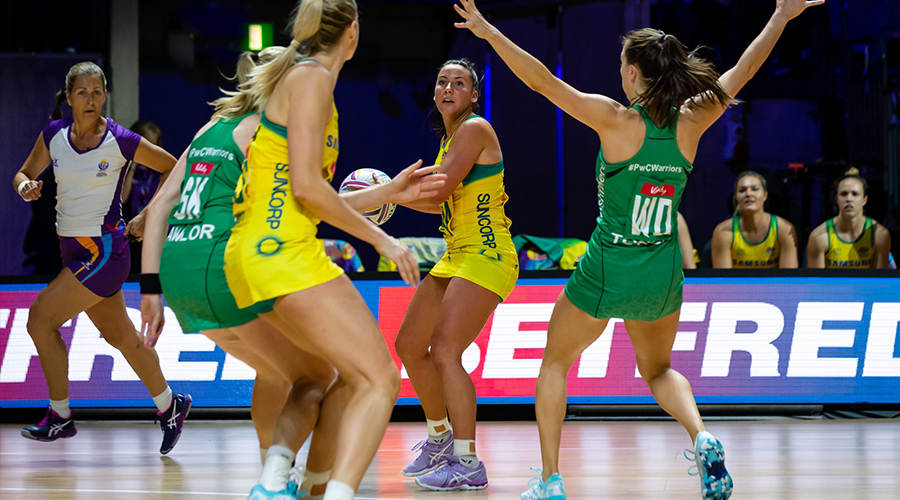 Australian Diamond Kelsey Browne looks to pass the ball to teammate Gretel Tippett against Northern Ireland at the 2019 Netball World Cup in Liverpool's M&S Bank Arena.