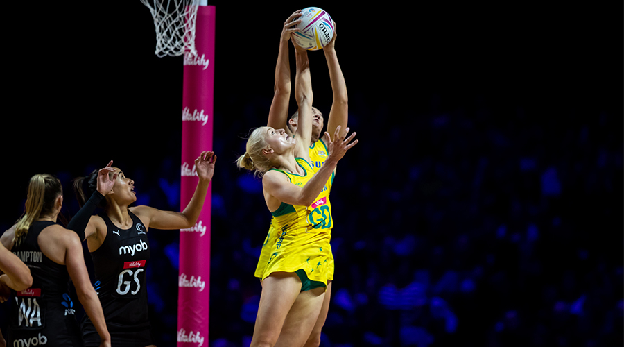 Australian Diamonds defenders Courtney Bruce and Jo Weston combine for an intercept against New Zealand in the 2019 Netball World Cup gold medal match in Liverpool