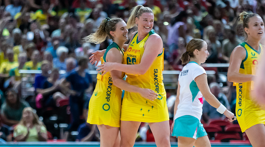 Caitlin Thwaites and Gabi Simpson of the Origin Australian Diamonds celebrate a goal during the Bushfire Relief Match in Sydney's Qudos Bank Arena.